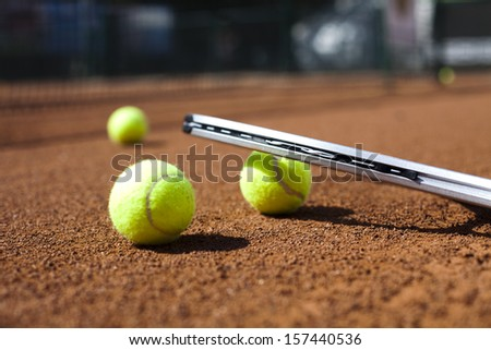 Tennis racket and balls, court - stock photo