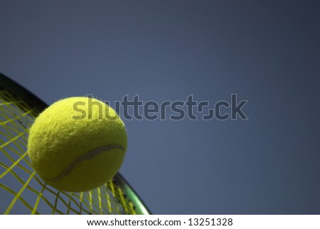 Tennis racket and yellow tennis ball sky blue - stock photo