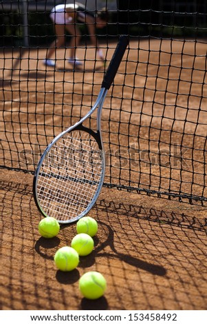Tennis racket with tennis ball  - stock photo