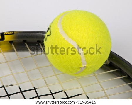 tennis racket with yellow ball - stock photo