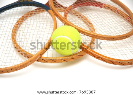 Tennis rackets and ball isolated on white - stock photo