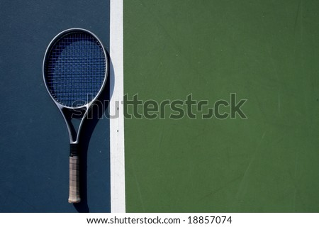 Tennis racquet on the court with room for copy - stock photo
