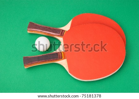 tennis racquets on a green table - stock photo