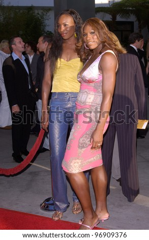 Tennis stars VENUS WILLIAMS (left) & SERENA WILLIAMS at the world premiere, in Hollywood, of Catwoman. July 19, 2004