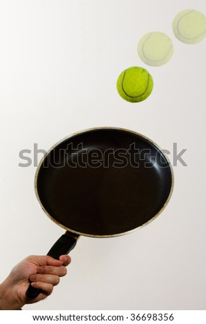Tennis with frying pan - stock photo