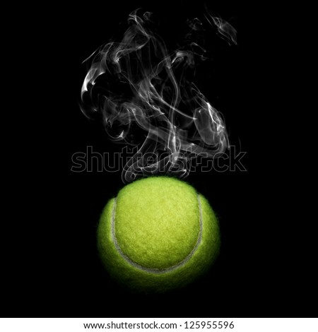 Tennis with smoke on black background - stock photo