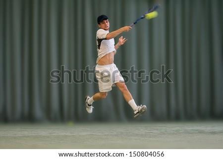 Tennisplayer hitting hard Topspin Forehand - stock photo