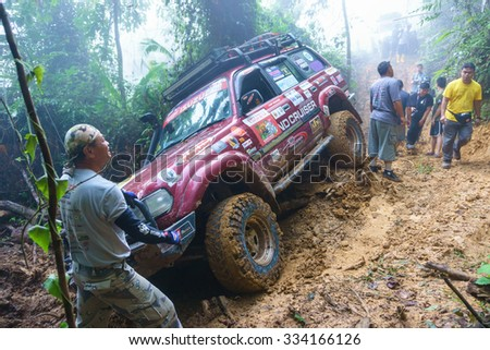 Tenom Sabah Malaysia - Oct 27, 2015:A group of adventurer trying to put the 4X4 car on track during jungle adventure in the jungle of Sabah Malaysian Borneo.Sabah jungle is popular for 4X4 adventure. - stock photo