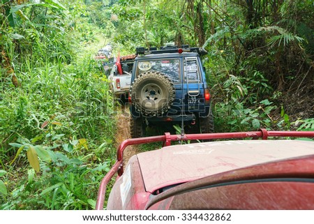 Tenom Sabah, Malaysia - Oct 26, 2015:A group of adventurers on 4X4 car passing a bush section during jungle adventure in the jungle of Sabah Malaysian Borneo.Sabah jungle is popular for 4X4 adventures. - stock photo