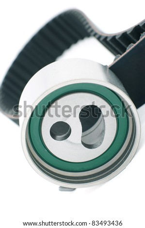 tension pulley and timing belt  background isolated - stock photo