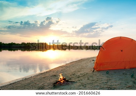 tent and campfire at night - stock photo