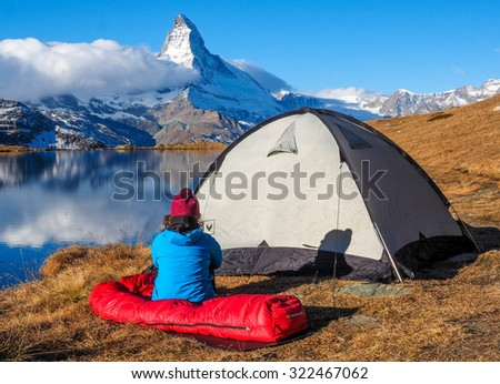 tent and camping in swiss alps - stock photo