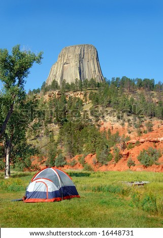 Tent camping by Devil's Tower Monument in Wyoming. - stock photo