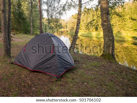 Tent in the forest on the river Gauja
