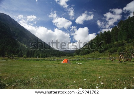 tent in the mountains - stock photo