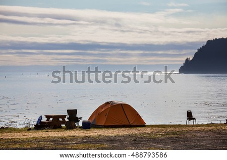 tent in waterfront camping in the Alaska. Summer season. Inspiring recreation.