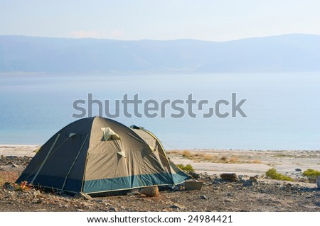 Tent, lake, blue sky and hills