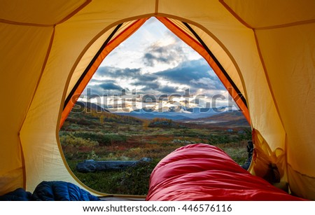 Tent lookout in the Morning on a hiking Tour in Northern Sweden - stock photo