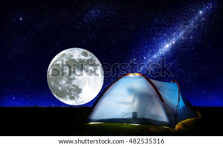 tent on the background of the starry sky