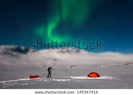 Tent, Skiing and northern lights - Miniature Effect - stock photo