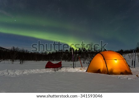 Tent under Northern Lights - stock photo