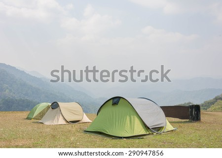 tents in camping area in Natural Park with mountain and sky view  - stock photo