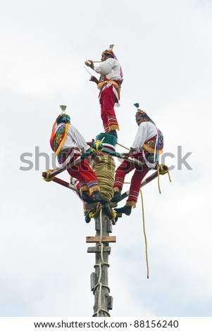 TEOTIHUACAN, MEXICO - AUGUST 13: The ancient ritual for a great harvest. Mexicans in national clothes perform traditional ritual descent down from a high pole on August 13, 2010 in Teotihuacan, Mexico