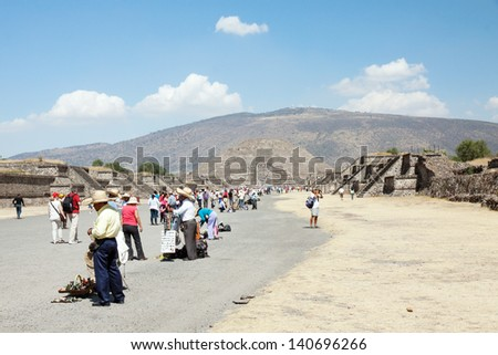 TEOTIHUACAN, MEXICO - FEBRUARY 4, 2013: Unknown people selling mayan souvenir in Teotihuacan, on the Avenue of the Dead leading to the Pyramid of the Moon on february 4, 2013 in Teotihuacan, Mexico  - stock photo