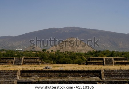 TEOTIHUACAN, MEXICO - MARCH 29: Pyramid of the Sun in Teotihuacan pyramid complex on March 29, 2009 in  Teotihuacan, Mexico. It's is a huge archaeological site with extensive pre-Columbian pyramidal structures - stock photo
