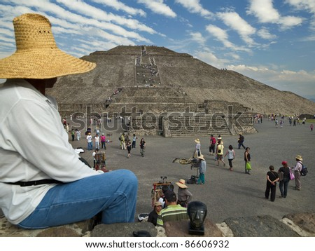 TEOTIHUACAN, MEXICO - MARCH 7: Tourist visit the Pyramid of the Sun in Teotihuacan on March 7, 2010, Mexico. Teotihuacan is the biggest pre-Colombian archaeological site in North America. - stock photo