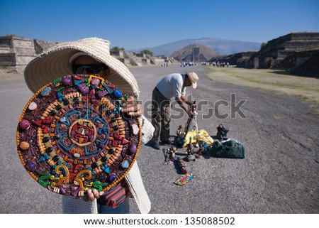 TEOTIHUACAN, MEXICO -MARCH, 3, 2012: Unknown people selling mayan calendar in Teotihuacan, on the Avenue of the Dead leading to the Pyramid of the Moon  on march 3, 2012 in Teotihuacan, Mexico, 2012 - stock photo