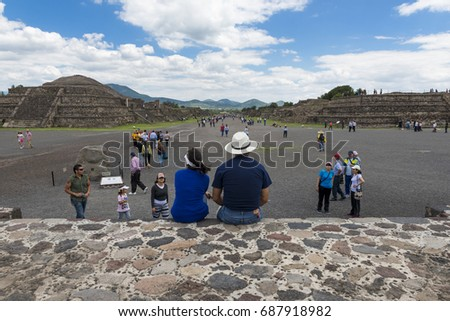 Teotihuacan, State of Mexico, Mexico - June 1, 2014: People at the Avenue of the Dead in the Teotihuacan archaeological site. Teotihuacan was one of the largest cities in the pre-Columbian Americas.