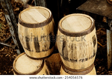 Tequila barrels stacked in a factory - stock photo