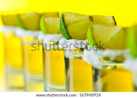 tequila , lime and salt , macro shot , focus on foreground - stock photo