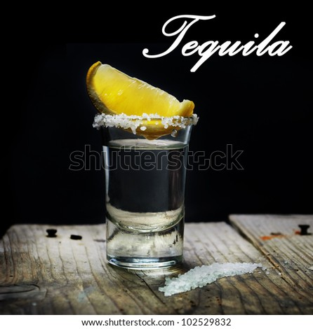 Tequila shot with lemon slice and salt - stock photo
