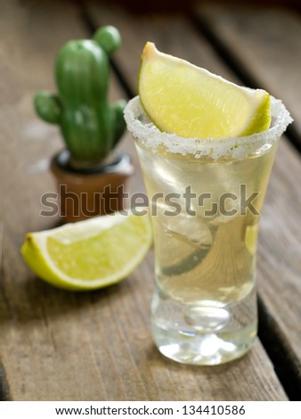 Tequila shot with lime, selective focus - stock photo