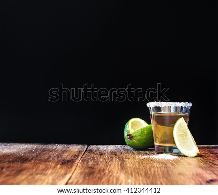 Tequila shot with lime slice with free text space. - stock photo