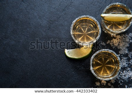 Tequila shots with lime slice and salt, top view - stock photo