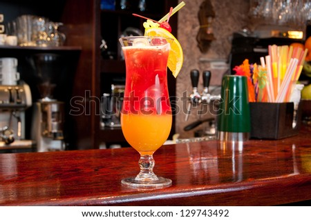 Tequila Sunrise cocktail at the bar. - stock photo