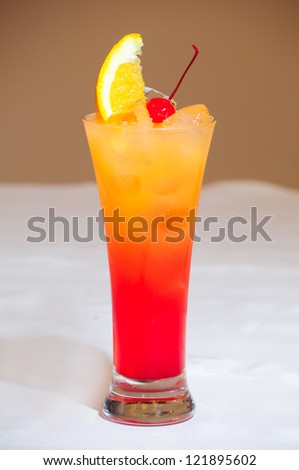 Tequila sunrise Cocktail isolated on a beige background - stock photo