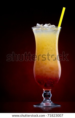 Tequila sunrise Cocktail isolated on a Red - stock photo