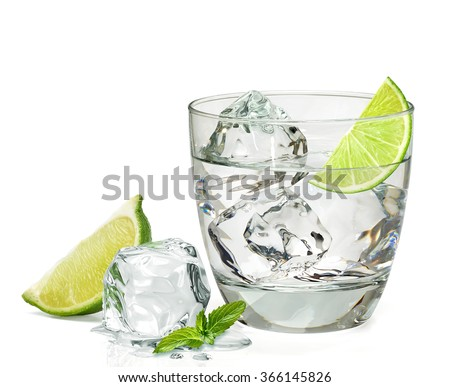 Tequila  with lemon in rocks glass on white background