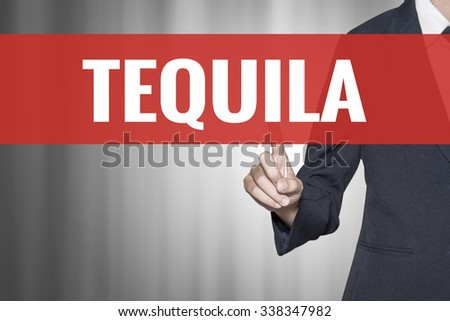 Tequila word on virtual screen push by business woman red tab - stock photo