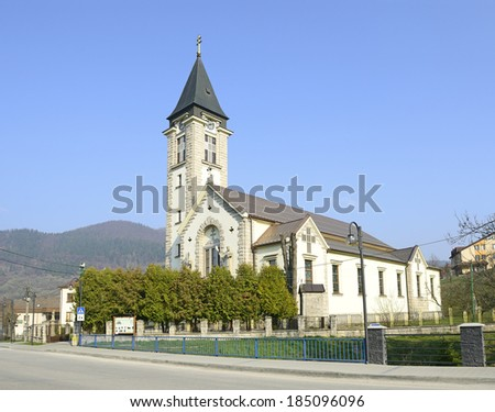 TERCHOVA, SLOVAKIA - MARCH 29: The village center and church on March 29, 2014 in northern Slovakia in Zilina district. With its location is a tourist center of Mala Fatra Mountains and cultural area.