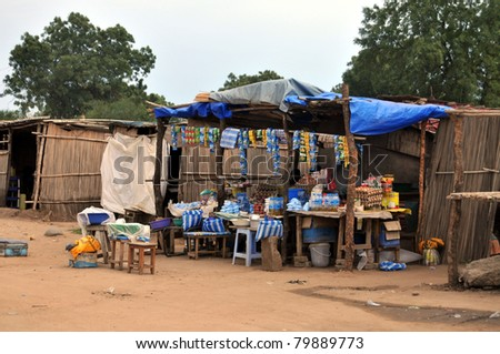 TEREKEKA - JUNE 11: Groceries and cellphone airtime are sold at a simple roadside shop in Terekeka, South Sudan, on June 11, 2011. South Sudan is one of the most undeveloped countries in the world. - stock photo
