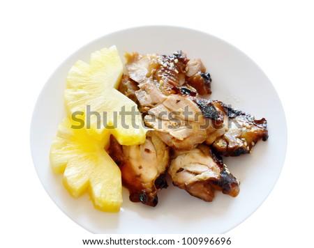 Teriyaki Chicken with fresh pineapple on white dish  - Japanese cuisine - stock photo