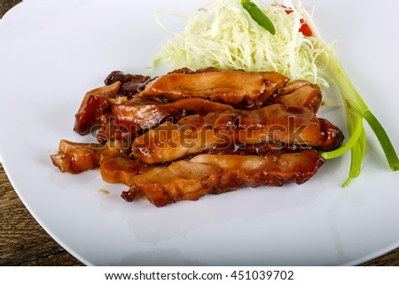 Teriyaki chicken with herbs and spices served cabbage
