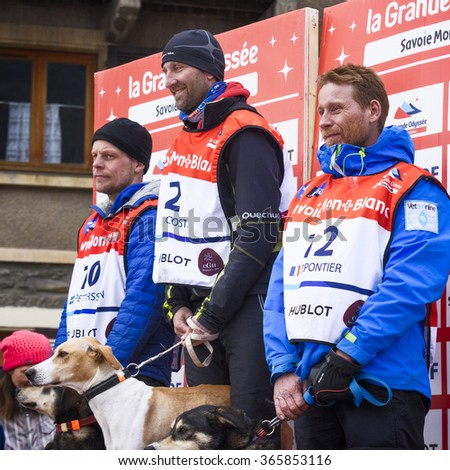 TERMIGNON, VANOISE, FRANCE - JANUARY 20 2016 - Podium Remy COSTE the winner of the GRANDE ODYSSEE the hardest mushers race, the 2nd Jimmy PETTERSSON and 3th named Jean-Philippe PONTHIER, Vanoise, Alps