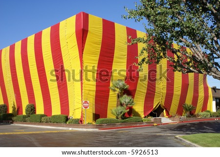 "termite pest fumigation tent covering building with funny ironic sign if front...""do not enter"" well now why would you want to? - stock photo"