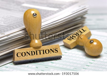 terms and conditions marked on rubber stamp - stock photo